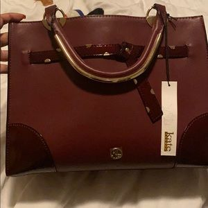 Maroon leather bag with strap